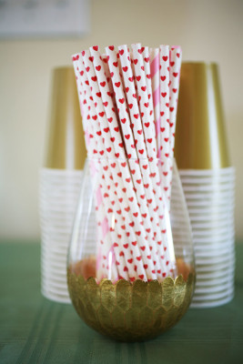 Gold party glass with decorative straws