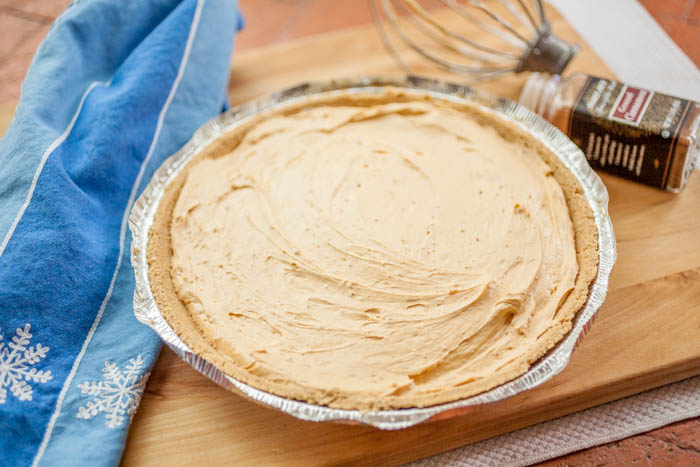 no-bake cheesecake with towel and whisk.