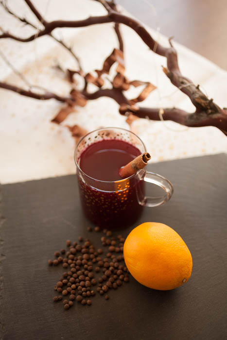 wassail in front of a branch and cookie cutter