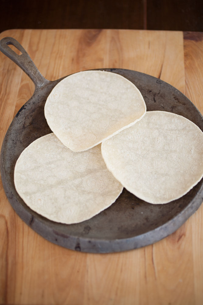 white corn tortillas and iron pan or comal