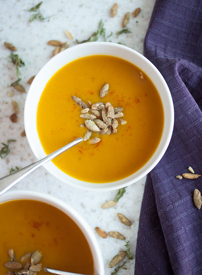 This simple, healthy recipe for spiced pumpkin and carrot soup will warm you up on cold fall evenings!