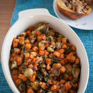 Savory Brussels sprouts with crisped edges are mixed with creamy sweet potatoes and crispy, flavorful bacon is the perfect easy-to-make Thanksgiving side dish!