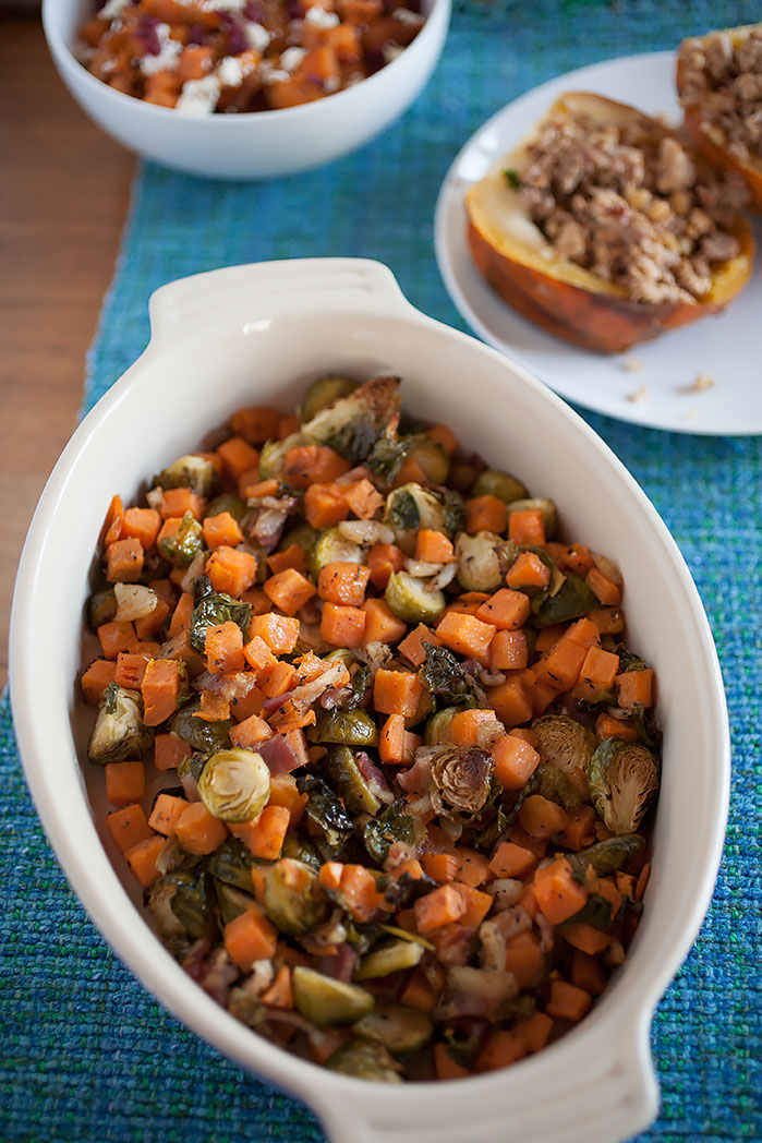 Savory Brussels sprouts with crisped edges mixed with creamy sweet potatoes and crispy, flavorful bacon makes the perfect easy-to-make Thanksgiving side dish!