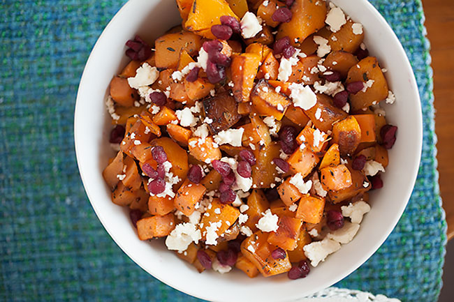 This easy Thanksgiving side dish has sweet from the butternut squash, sweet potatoes, and roasted onions, salty creaminess from the feta cheese, a delicious savory layer from the Greek herbs, and a sweet tang from the pomegranate seeds! And most of the work is done by the oven!