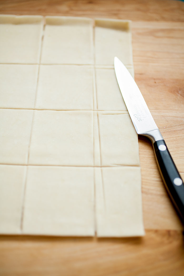 Squares of puff pastry dough for caramelized onion and goat cheese tarts
