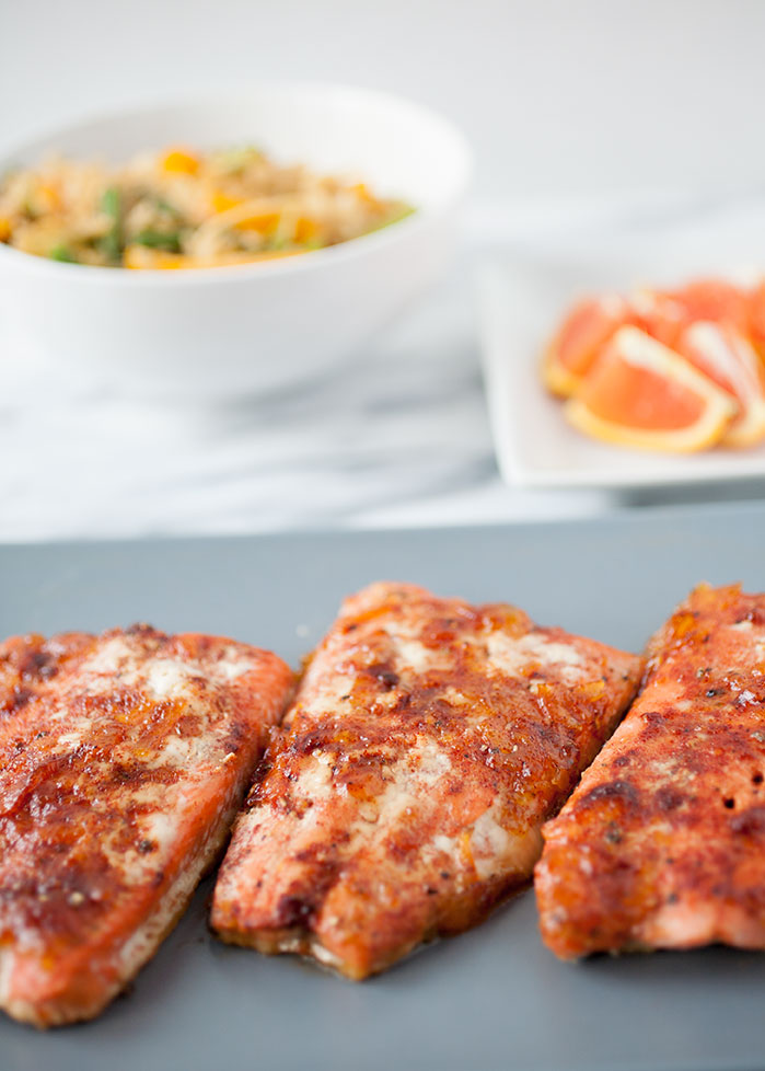 The orange and red chile in this orange red chile salmon adds a beautiful flavor and a spicy bite for a healthy and delicious New Year.