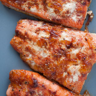 The orange and red chile in this orange red chile salmon adds a beautiful flavor and a spicy bite for a healthy and delicious for the New Year.