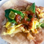 corn tortilla with scrambled eggs, potatoes, avocado, and salsa for breakfast tacos from Flurries of Flour