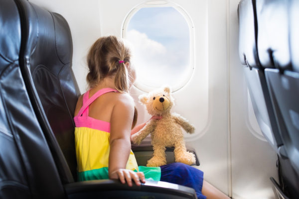 a child on a plane for traveling without the stress even when you're traveling with children.